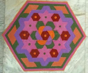 Margazhi Day 23 Kolam - A dotted rangoli with recycled colours. 15-8 interlaced dots.