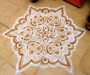 Rangoli: Dotted kolam in white with  Red kaavi