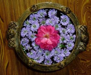 Flowers in a Urli