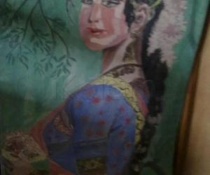 Rangoli: Painting of a South Indian young Girl.