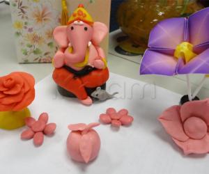 Rangoli: Color clay dough Ganesha