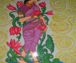 Rangoli: lady painting frame work