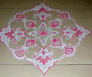 Pink and white design kolam