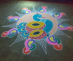Rangoli: peacock with drum