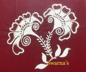 Flower rangoli in white