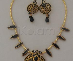Black leaf shaped crystal beads chain_with peacock pendant & earring set