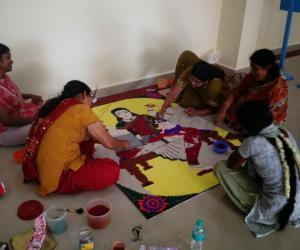 preparation of rangoli multi tasking lady
