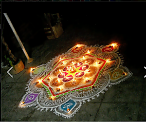karthigai kolam with diyas