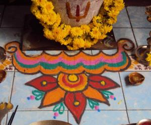 Rangoli: kolam in front of tulsi