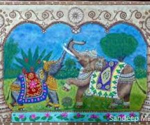 An African Elephant and Indian Elaphant greeting