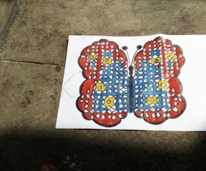 butterfly rangoli with dots