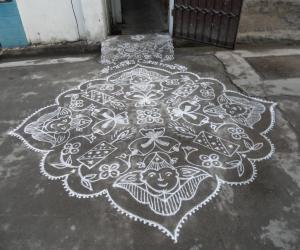 Rangoli: Kolam in white. Joker, candle & bell for christmas.