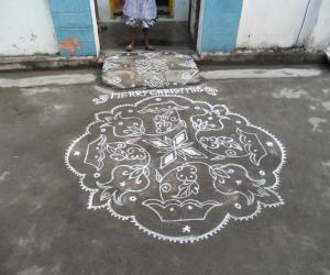 Rangoli: Kolam in white. Christmas.