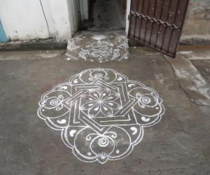 Very simple and different kolam in white.