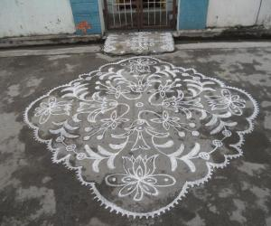 Different kolam in white. Flowers.