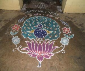 Happy New Year-Peacock on lotus rangoli