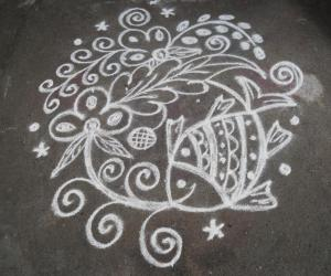 My daily  kolam. Fish with pookothu.