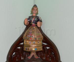 Thanjavur thalaiatti bommai decorated with chemkies.