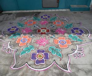 Flower kolam with lotus & leaves in different style.