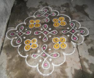 Chikku & flower kolam, Very simple.