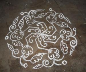 Daily kolam in white.