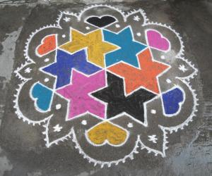 Rangoli: Star with in star, in bright colours.