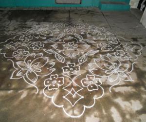 Lotus kolam in white.