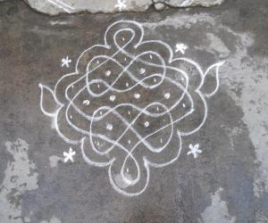 Small chikku kolams with 8 shape.