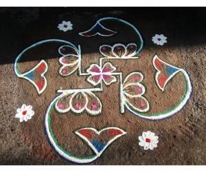 Rangoli: Rev's daily kolam in swastik.