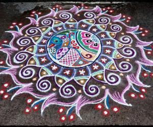 Rangoli: Rev's peacock flowered new  designer rangoli.