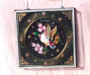 Craft with pins,golden thread & bird and flower decoration.