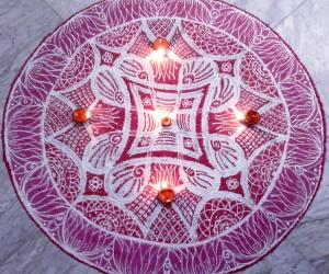 Rangoli: Double stroke padi kolam for Panguni Uthiram with kolamavu and red colour.