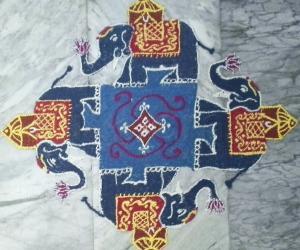 Rangoli: Elephant rangoli with 19-1straight dots.