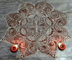 Freehand kolam  for margazhi with rice flour and kavi