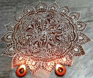 Rangoli: freehand rangoli with rice flour and kavi from my margazhi kolams