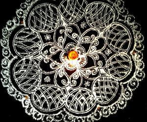 Friday pooja kolam with rice flour.