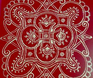 Rangoli: Iyengar padi  kolam with rice flour on red plastic cover