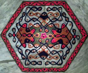 Rangoli: A butterfly chikku with 11-6 interlaced dots
