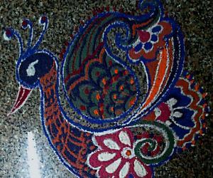 A Freehand Peacock Rangoli