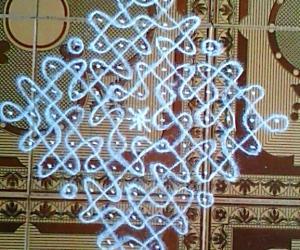 Chikku kolam with 13-1 straight dots.