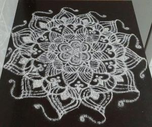 freehand rangoli with rice flour