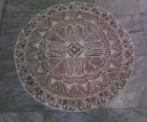 Free hand kolam with rice flour and kavi for margazhi
