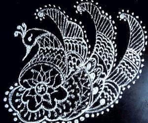 Freehand peacock rangoli with lotus and small swastik