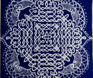 Chikku Kolam with 21-1 straight dots on blue plastic cover.