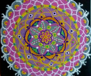 A Freehand Pooja kolam with recycled colours