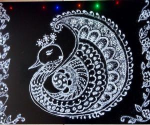 White Peacock Rangoli for Saraswathi Pooja