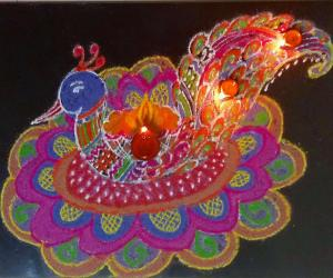 Peacock Rangoli with diyas