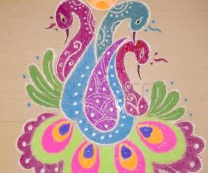 peacock rangoli with diya