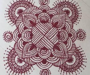 Rangoli: Free hand design with recycled colours