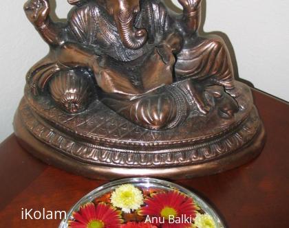 Rangoli: Flowers in glass bowl